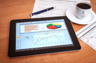 tablet with excel spreadsheet showing charts