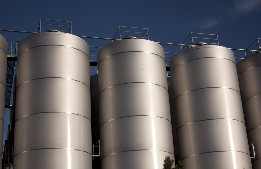 three silver silos of a factory