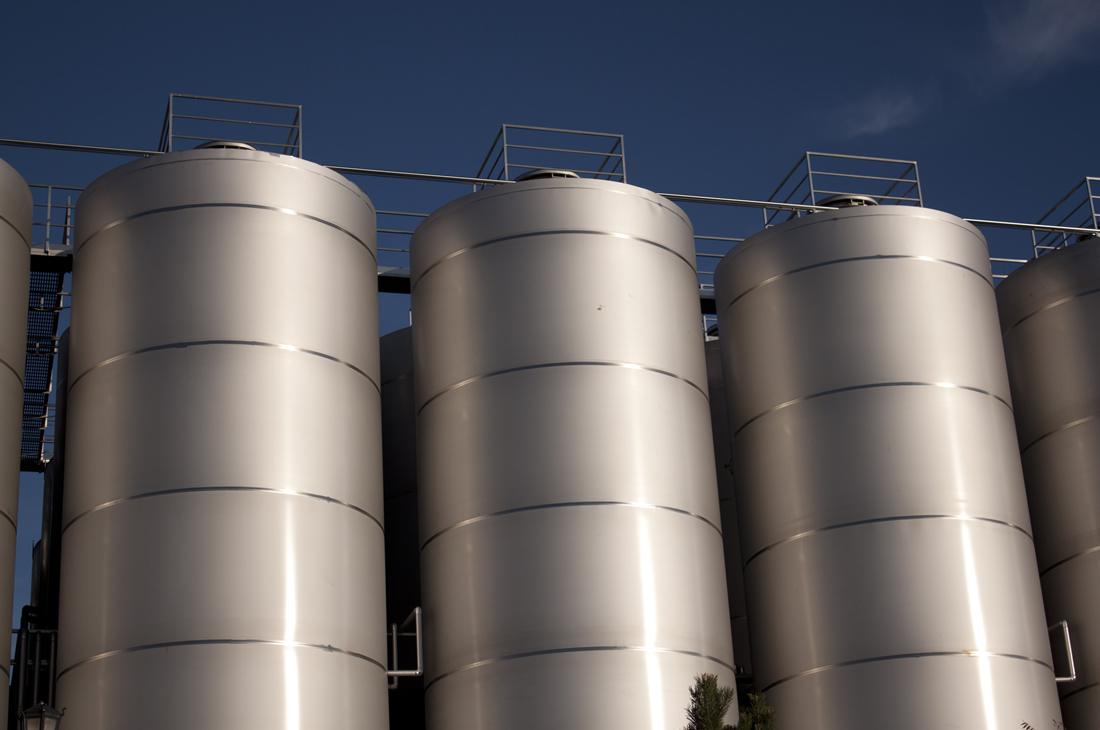 three silos of a factory